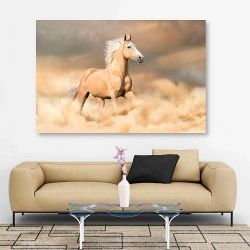 Πίνακας σε καμβά Palomino horse with long blond male run in dust